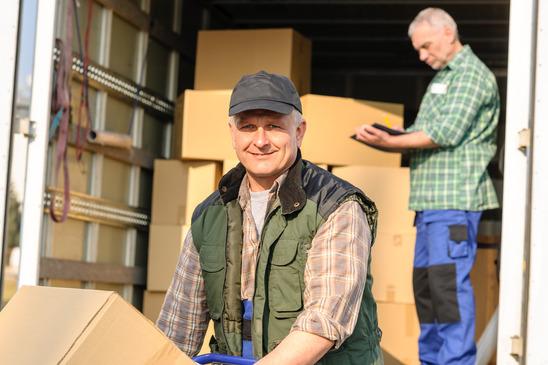Delivery service mover man cardboard box